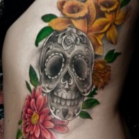 Gray sugar skull with red and yellow flowers tattoo