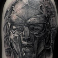 Gray washed style detailed shoulder tattoo of gladiator portrait