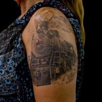 Gray washed style large shoulder tattoo of old train