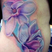 Great blue orchids tattoo on ribs