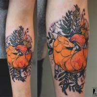 Great designed by Joanna Swirska forearm tattoo of sleeping fox with leaves