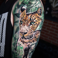 Great Jaguar and Explorer tattoo on shoulder