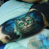 Great looking colorful Cheshire cat tattoo on biceps