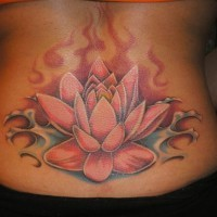 Great lovely red lotus flower tattoo on lower back