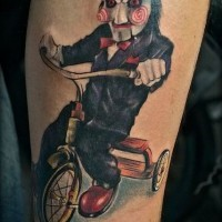 Great painted and colored movie villain on bike tattoo