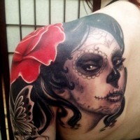 Great santa muerte girl with a rose in black hair tattoo on shoulder