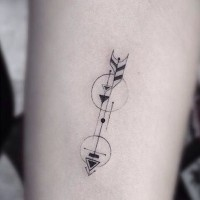 Great simple painted black ink arrow shaped tattoo on arm