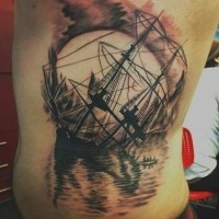 Great sinking ship at sunset tattoo on back