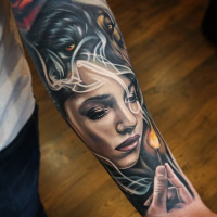 Great woman and match tattoo on forearm