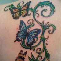 Green vine with butterflies tattoo on back