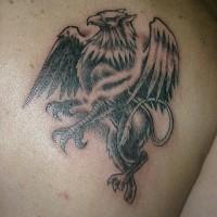 Griffin tattoo on back shoulder for boys