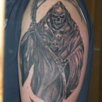 Grim reaper  with amulet tattoo on shoulder