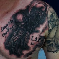 Grim reaper and lettering tattoo on chest by Chris Black