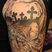 Tatuaje en el brazo, la parca en el cementerio