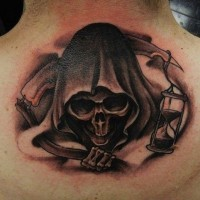Grim reaper with sand clock tattoo on back by geri