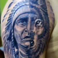 Half face of native american man half wolf tattoo on shoulder