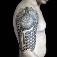 Half geometric half ornamental style tattoo on shoulder