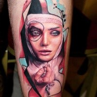 Half realism half abstract style tattoo of woman with cross