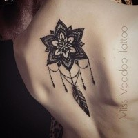 Henna like black ink painted by Caro Voodoo upper back tattoo of big flower with feather