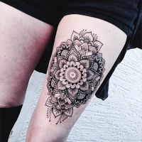Hinduism style black ink arm tattoo of beautiful flower