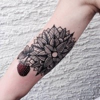Hinduism style colored arm tattoo of ornamental flower with berry