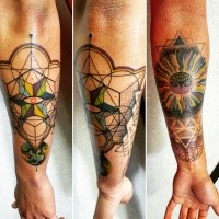 Hinduism style colored forearm tattoo of various ornaments and mystic sun