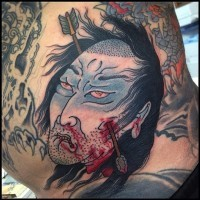 Homemade Asian style colored bloody man head with arrow