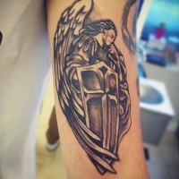 Homemade black ink holy angel warrior tattoo on biceps