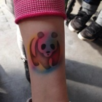 Homemade like colored forearm tattoo of panda silhouette