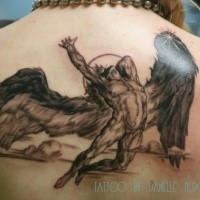 Homemade style black and gray upper back tattoo of falling Icarus