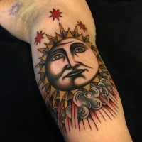Homemade style colored biceps tattoo of sun with stars