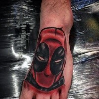 Homemade style colored foot tattoo of Deadpool head