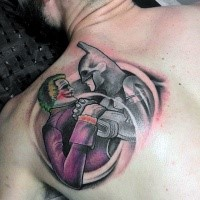 Homemade style colored scapular tattoo of Batman and Joker