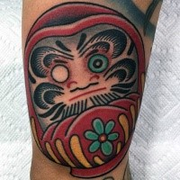 Homemade style colored tattoo of cute daruma doll with green flower