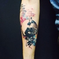 Homemade watercolor style forearm tattoo of Yin Yang symbol