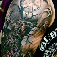 Horrible tree death tattoo on arm
