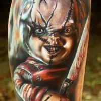 Horror movie creepy colored maniac doll tattoo on leg