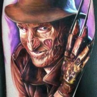 Horror movie Freddy Krueger colored portrait tattoo on leg