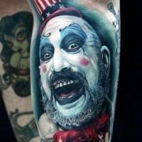 Horror movie like colored evil Joker tattoo on arm