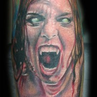 Horror movie like colored leg tattoo of evil bloody vampire woman