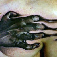 Horror movie like colored realistic zombie hand tattoo on chest