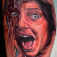 Horror movie like colored scared woman tattoo on leg