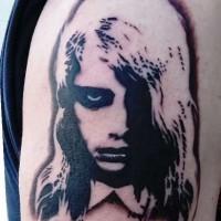 Horror movie like creepy painted girl tattoo on shoulder