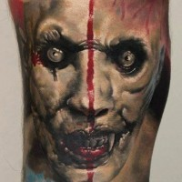 Horror movie like creepy very detailed colored vampire monster tattoo on arm