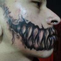 Horror movie style black ink monster teeth tattoo on mouth