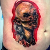 Horror movie style old vampire colored portrait tattoo on belly