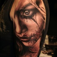 Horror movie themed very detailed bloody woman tattoo on arm