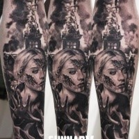 Horror style black ink forearm tattoo of zombie woman with burning church