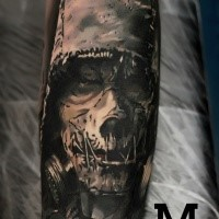 Horror style colored arm tattoo of evil maniac with gas mask
