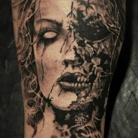 Horror style colored leg tattoo of corrupted woman face